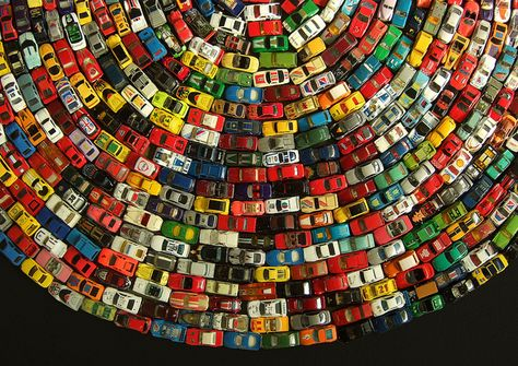 Toy Atlas Rainbow - David T. Waller - The Toy Atlas Rainbow is a wonderful installation of old toy cars by UK artist David T. The piece won the People's Award at the Arts Depot Open last year - cf. Here the cars are non-ordered by color!