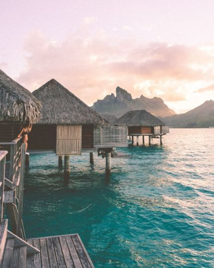 Sunset from our overwater bungalow at Four Seasons Bora Bora for our honeymoon v. Sunset from our overwater bungalow at Four Seasons Bora Bora for our honeymoon via Find Us Lost