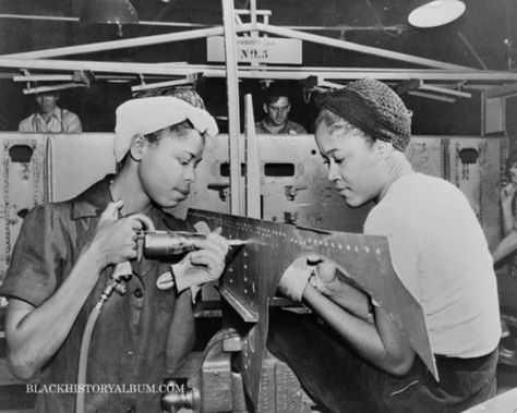 Young African American women employed by the Douglas Aircraft Company in Long Beach, California, 1938. Two of thousand of African Americans who worked in arms and munitions plants on the West Coast during World War II.