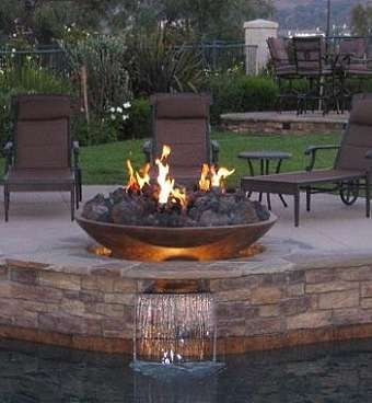 I wonder if something like this could double as a table - when the fire's not on of course! gas fire pits