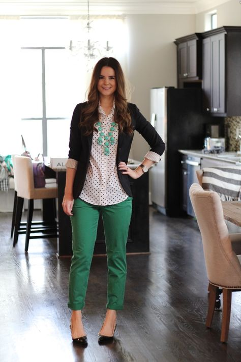 Veronika's Blushing: Black blazer, polka dot blouse, green pants, black flats, and statement necklace.