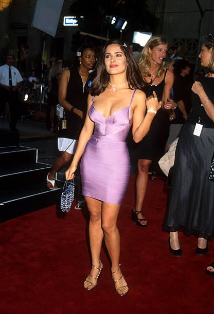 Hot salsa Salma Hayek and her bombshell curves packed into a tight lavender bandage dress and sexy gold high heel sandals - Wow!