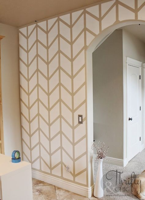 Tutorial on how to paint a herringbone pattern on a wall using painters tape