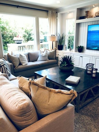 This Room Love How They Pushed Together Two Coffee Tables To Make A Huge Square Giving So Much Us Modern White Living Room Home Small Apartment Living Room