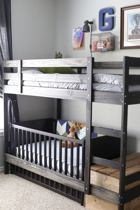 Multiple Kid solution: You may have to look twice to spot the crib in this room shared by four brothers.