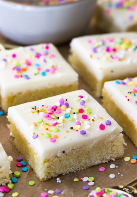Buttery-soft sugar cookie bars topped off with a sweet buttercream frosting and plenty of colorful sprinkles! #sugarcookie #cookiebars #sprinkles #dessert #recipe