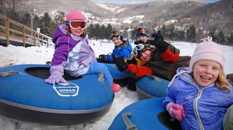 Many winter sports resorts like Sugar Mountain feature a snow-tubing activity fo… Many winter sports resorts like Sugar Mountain feature a snow-tubing activity for family fun.