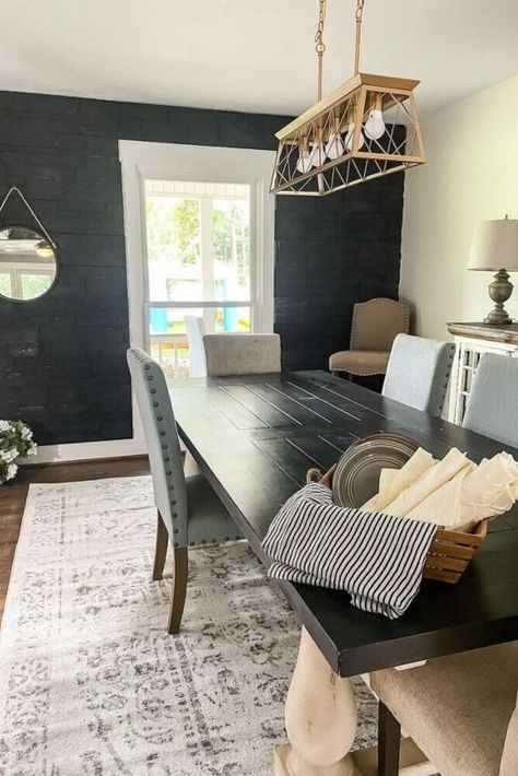 We can't get over the before and after transformation of this dining room accent wall. Check out how to make a stone accent wall on a budget. Easy DIY accent wall for entryway or living room. #diy #accentwall #diningroom