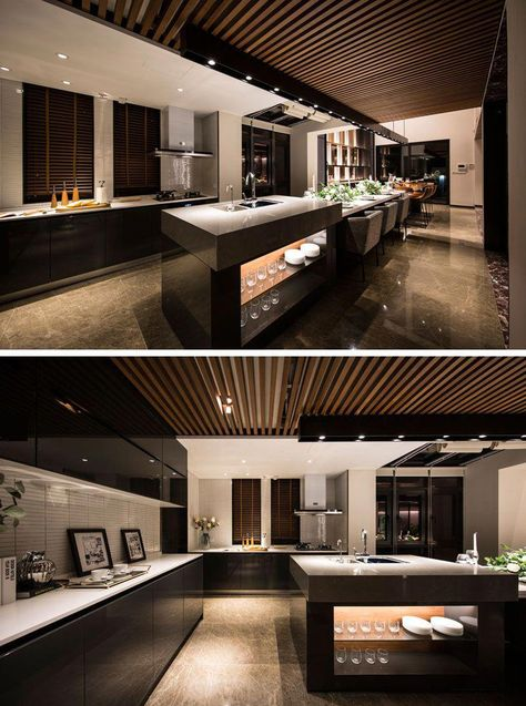 this long and modern kitchen island is home to a bar a