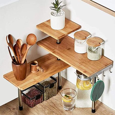 A three-tier corner shelf that'll give ya a creative, pretty-looking solution to your all-too-frequent where the heck do I put this problem.