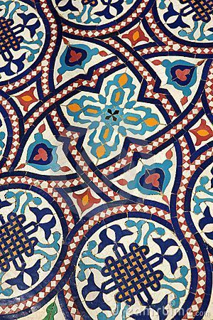 Moroccan mosaic tilework by Daniel Gilbey, via Dreamstime…something unique for our small bath...