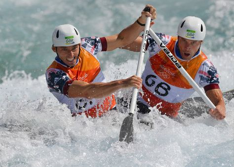Britain's David Florence (L) and Richard Hounslow compete in the Men's C2 semifinal canoe slalom competition at the Whitewater stadium during the Rio 2016 Olympic Games in Rio de Janeiro on August 11, 2016. / AFP / Carl DE SOUZA (Aug. 10, 2016 - Source: AFP)