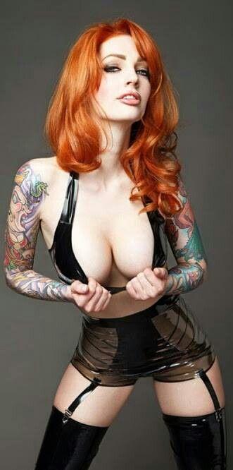Busty tatooed redhead