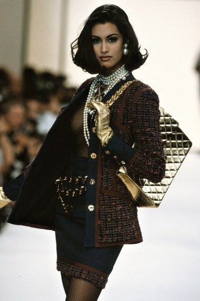 Yasmeen Ghauri walks the runway during the Chanel Ready to Wear show as part of Paris Fashion Week Fall/Winter in March, 1991 in Paris, France. Get premium, high resolution news photos at Getty Images