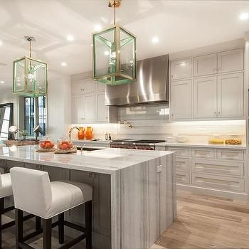 spectacular kitchen features a pair of goodman hanging lamps