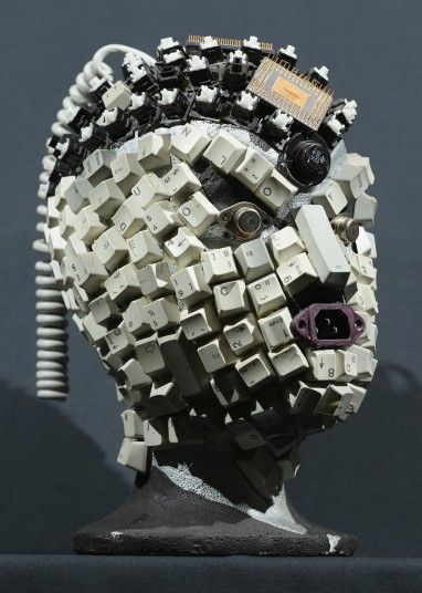 A bust whose surface is completely covered in electronics stands at the electronics repair shop owned by Muharrem Batman in Berlin, Germany.