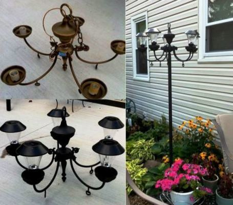 Bought an old light fixture for $5.00..painted it black…replaced the bulbs with solar lights…and then I was going to hang it from a shepherds hook..but then I noticed it would slide right into a piece of conduit…so I painted that black also. Inserted that into the ground. Instant light with no wiring!
