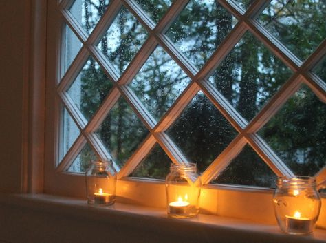 candles in the window - recycled jars