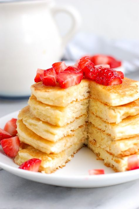 These fluffy paleo pancakes are the best homemade pancakes ever! Made with almond flour and tapioca flour, they turn out perfectly light, fluffy, golden, and can be made with coconut or almond milk! #paleopancakes #glutenfreepancakes #glutenfree #healthypancakes #dairyfree #pancakes #fluffypancakes #healthybreakfast #breakfast #pancakes | erinliveswhole.com