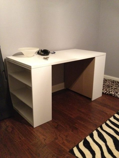 My new craft/sewing table.  Need to paint or cover the backs of the shelves.  Made with two $15 bookshelves from Walmart and one $35 table top from Ikea.  Total Cost $65.  First step in creating my craft room.  Let the fun begin. :)