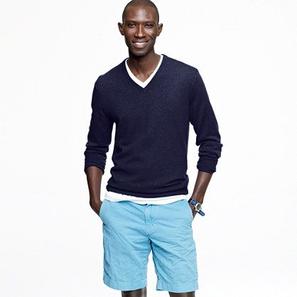 White shirt, cotton shorts, cashmere v,neck sweater