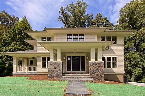 The more I look at this house the more I love it. Very cool modern spin on traditional craftsman style houses.