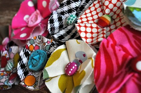 These would be so cute as barrettes, glued onto a frame, or pinned to a purse or shirt.  I think even my girls could do this!  Hmmm...I'm thinking potential girl scout craft~