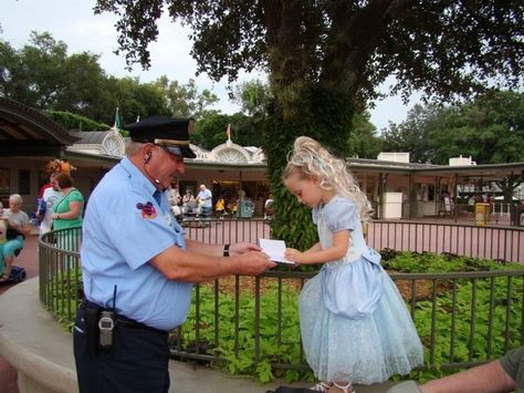 """""""This would be a man that loves going to work and does not dread it the night before. Upon entering the Magic Kingdom, one of the security guards said to the girl """"Excuse me Princess, can I have your autograph."""" I could see that the book was filled with children's scribbles as the guard asked the same question of many little Princesses. The little girl could not get over the fact that the guard thought she was a real princess.""""  very cute thing to do"""