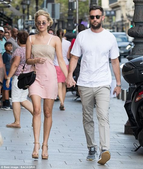 Cosy: Jennifer Lawrence, 27, proved her romance is going from strength-to-strength alongsi... #jenniferlawrence