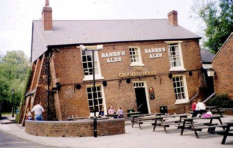 """Pubs come in all shapes and sizes in England but there aren't many  quite like """"The Crooked House"""" in Staffordshire,"""