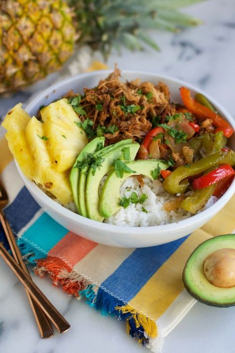 This Crock Pot Pineapple Pork Burrito Bowl recipe is so easy to make in a slow cooker and delicious, too! You'll love how fragrant your house becomes as this gluten-free and dairy-free recipe turnsinto the most tender pork!The pork is paired with white rice, fresh pineapple, sliced avocado, cilantro, and sautéed onions and peppers. This meal is great for meal prep but also for serving for an easy weeknight meal. Just let it cook all day in the slow cooker and serve! #recipe #glutenfree