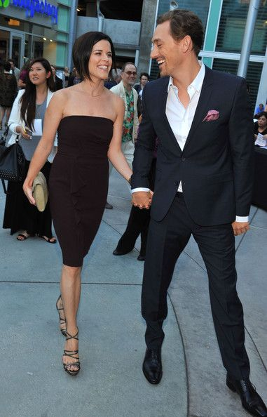 Neve Campbell JJ Feild Photos - Actors J. Feild (R) and Neve Campbell arrive at the premiere of 'Austenland' at ArcLight Hollywood on August 2013 in Hollywood, California. - 'Austenland' Premieres in Hollywood