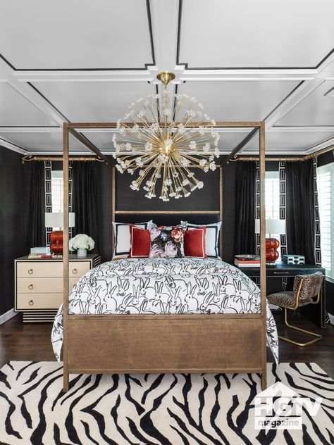 An oversized white pendant, black and white fabrics and black painted walls make this master bedroom super glam. See more on HGTV.com.