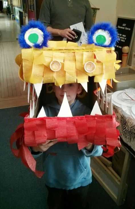 One of our visitors shows off our dragon in progress.