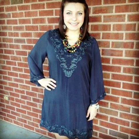 Add this top with a pair of leggings and our Frye boots for the perfect fall outfit!