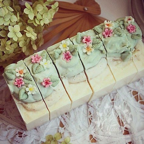 I love the top. Looks as if 3 types of soap were used. The flowers and petals maybe a small silicone mold from ikea to replicate look.