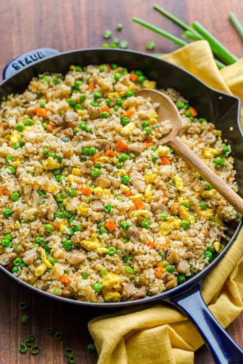 Chicken Fried Rice is one of our go-to EASY 30-minute meals. Fried Rice is perfect for meal prep and a genius way to use leftovers. It's actually even better with leftover rice. #chickenfriedrice #friedrice #chickenrecipes #30minutemeals #natashaskitchen #rice #friedricerecipe