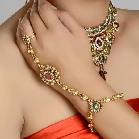 Gold plated polki ring bracelet has Indian traditional design It