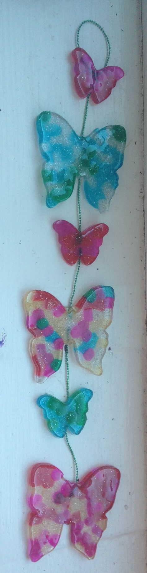 Butterfly melted beads sun-catcher. Note glitter beads, transparent and pearl. great summer project must try! :: ecrafty