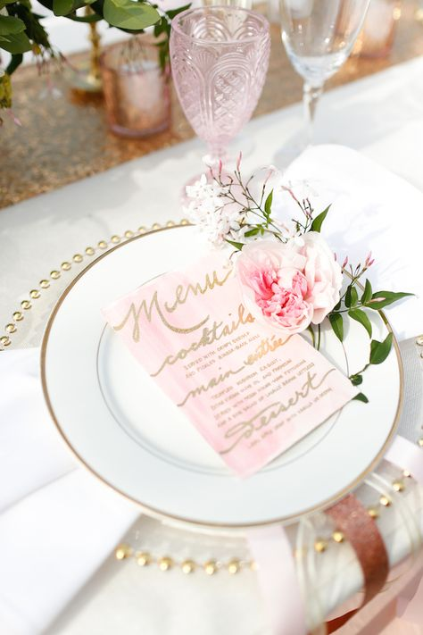 Pretty pastel place setting with watercolor menu and colored glass.