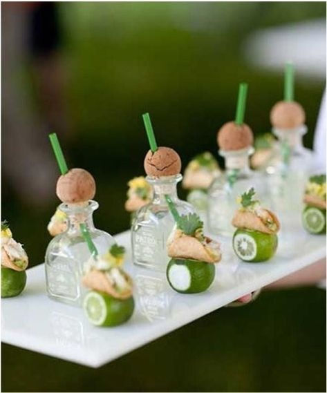 Mini tequila shots and tacos.  This is great and so idealistic for a summer wedding, bachelorette party, or bridal shower.    DIY Alert - Purchase mini tequila bottles at your local liquor store, make a diagonal hole in the cork to place the straws, and voila!