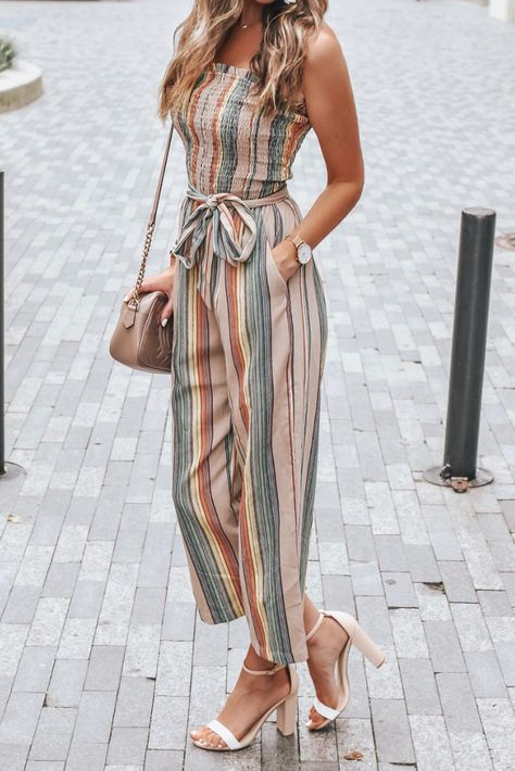 Fawn Striped Jumpsuit - Fawn Striped Jumpsuit The perfect stripe jumper for a summer to fall transition outfit! The strapless top and tie belt makes for a casual outfit that you can wear every weekend! or with the girls?