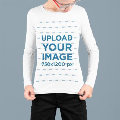 Placeit -  Mockup of a Kid Looking At His Long Sleeve Tee at a Studio