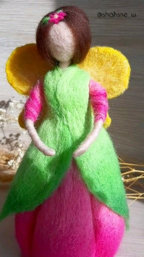 """This unusual #feltdoll will be a wonderful #decoration in a #nursery or in any other room. The graceful and bright doll will suit any interior. Such a #beautifuldoll is a pleasant and gentle gift for your loved ones and people! It also makes a thoughtful gift for a new or future mother.  DOLL SIZE 9"""" (23 cm) х 4,5"""" (12 cm)"""