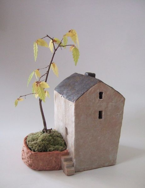 Cute ceramic house and planter idea