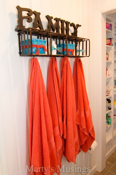 Love the repurposed CD rack! A Small Bathroom Remodel from Marty's Musings