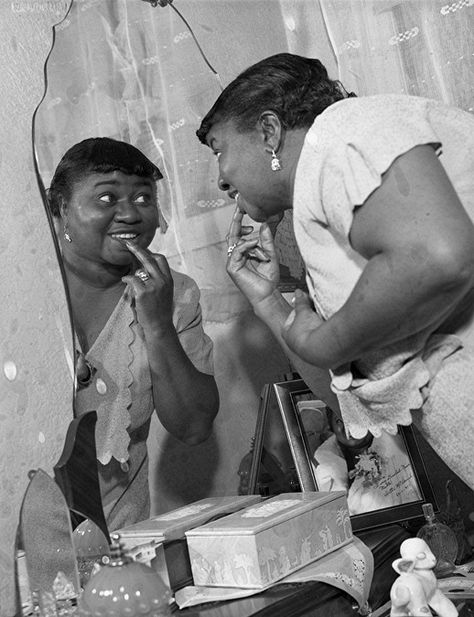 """Gone With the Wind actress Hattie McDaniel at her dressing mirror. Headlined the Los Angeles Times: """"'God first, my work next -- and a man last!' That's Hattie McDaniel, who's free, forty and famous."""" // Hattie McDaniel  Born: 10-Jun-1893  Birthplace: Wichita, KS  Died: 26-Oct-1952  Location of death: Woodland Hills, CA  Cause of death: Cancer - Breast"""