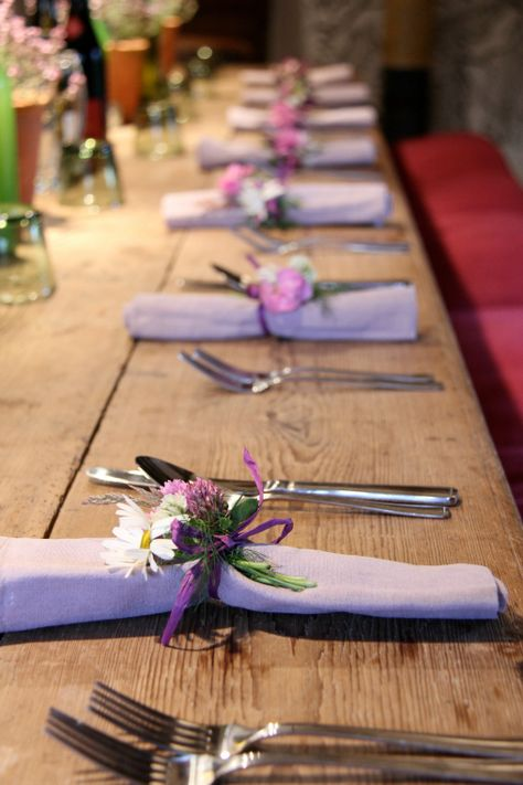 The table in the granary set for lunch with Ursula's beatiful napkin posies. June 2013, Allt-y-bela garden courses.