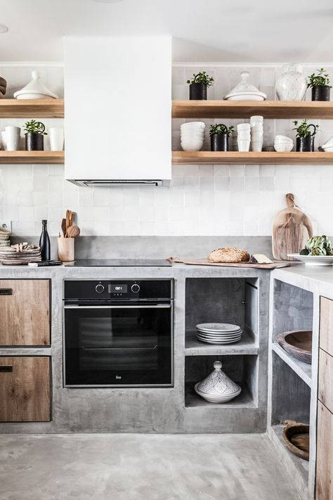 Concrete, wood and white kitchen with Zellige tiles