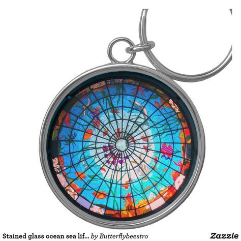 Stained glass ocean sea life keychain. #oceankeychain #stainedglasskeychain #fishkeychain #tropicalkeychain #butterflybeestro